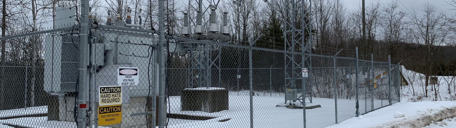 Electrical substation with warning signs